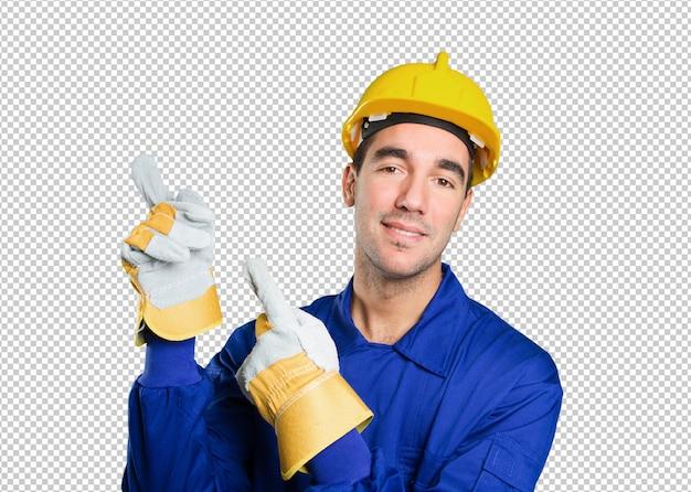 白い背景を指す驚いた労働者