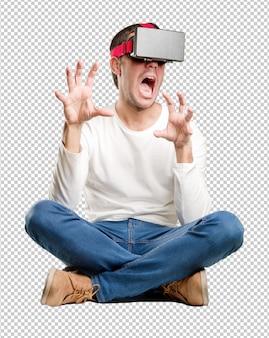 仮想現実眼鏡を使用して座っている若い男