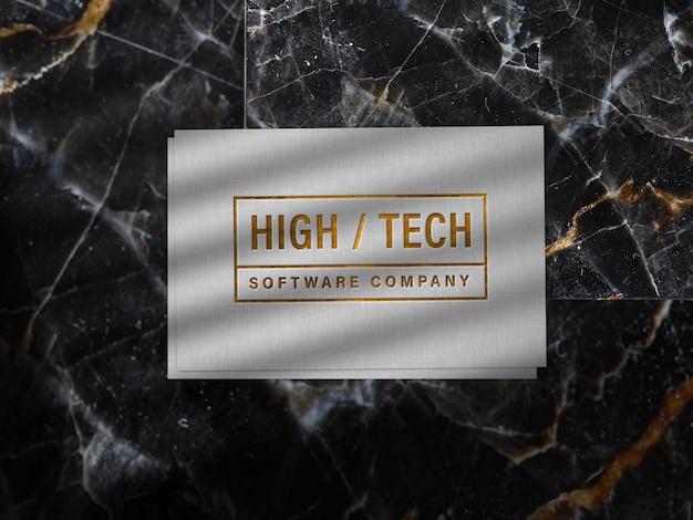 Рельефный золотой логотип на льняной бумаге