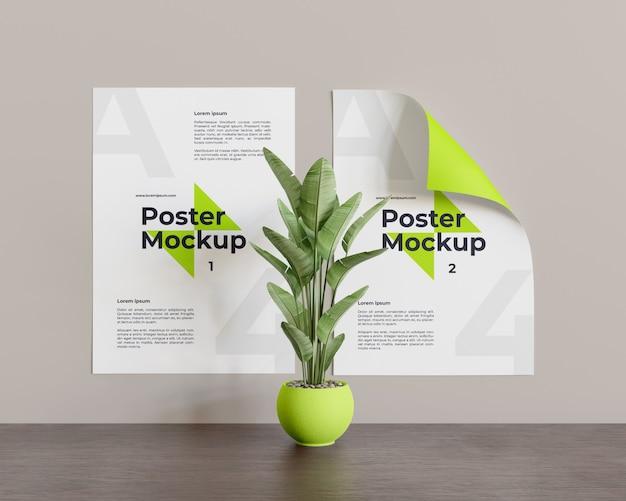 正面の真ん中にある植物とポスターのモックアップ