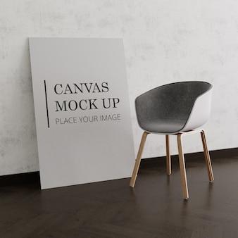 椅子とモックアップされたキャンバス