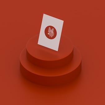名刺のモックアップと単色の赤いシーン