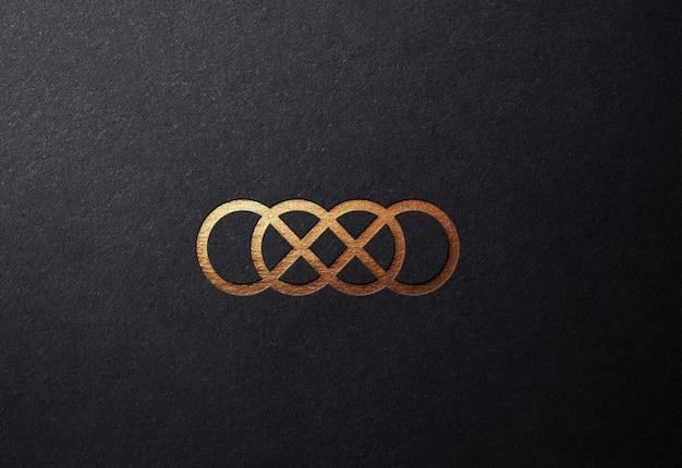 Роскошный макет золотого логотипа на плоской рельефной поверхности