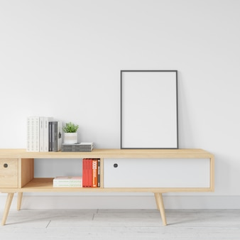 木製のテーブルに空白の白いフレームモックアップ