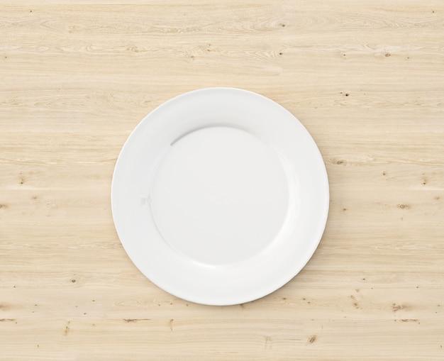 木製のテーブルの上から見る白いプレート