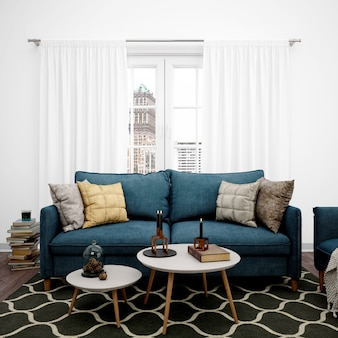Гостиная с элегантным диваном и большим окном, книги сложены на полу