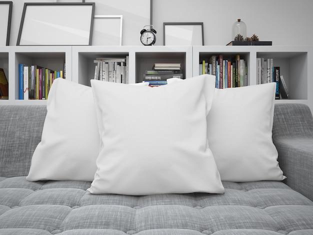 ソファの上の白い空白クッションモックアップ