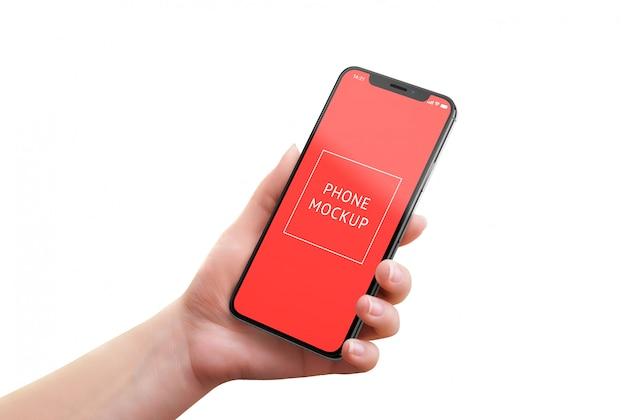 女性の手で現代のスマートフォンのモックアップ。等尺性の位置。