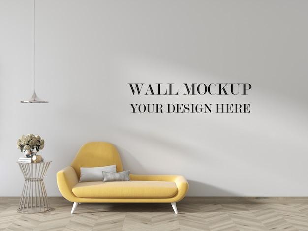 小さなソファ付きのリビングルームの壁のモックアップ