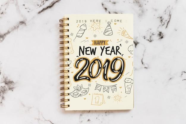 新年コンセプトのノートブックモックアップ