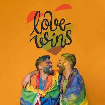 ゲイプライドの日に恋に男性のカップル。愛が勝つ