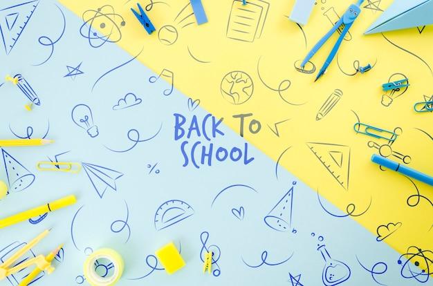 カラフルな背景を持つ学校に戻るトップビュー