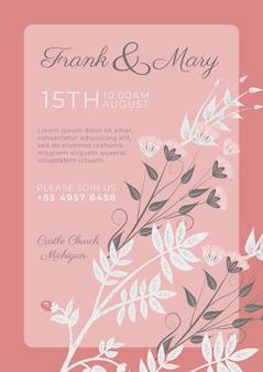 白の装飾用の花とピンクの招待状