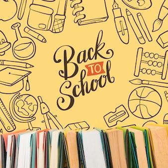 黄色の背景で学校に戻るトップビュー