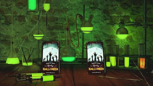 スマートフォンと緑色のライトのハロウィーンの配置