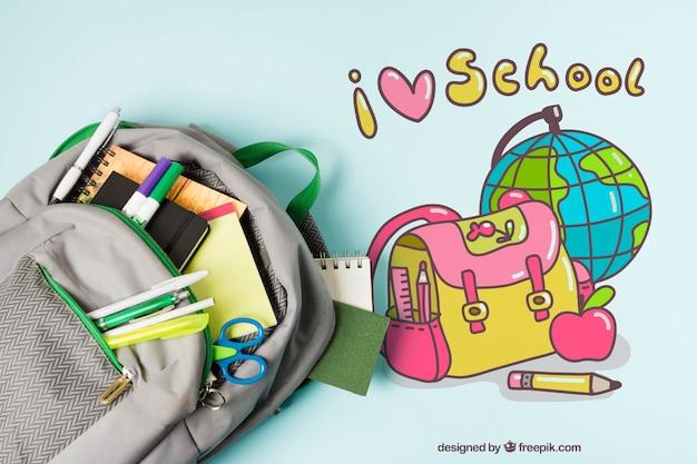 Расположение сверху со школьной сумкой