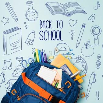 Вид сверху синяя школьная сумка с принадлежностями