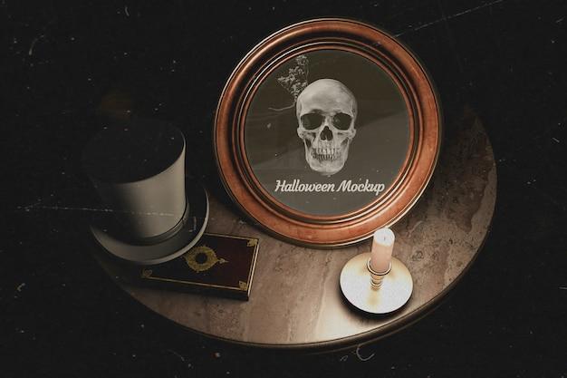 頭蓋骨とハロウィーンラウンドフレームの暗いテーブルデザイン