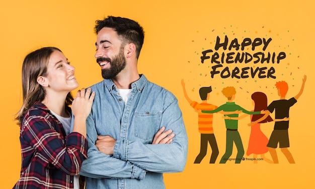 手描きのメッセージの横にかわいい若いカップル