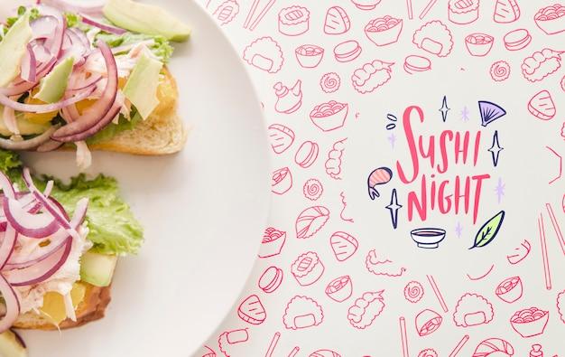 ピンクの背景を持つ食品のプレートのフラットレイアウト
