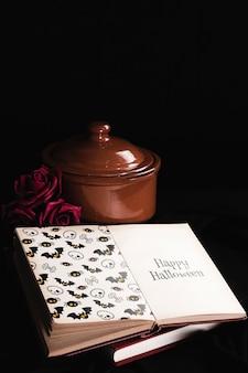 モックアップ本と黒の背景のハロウィーンコンセプト