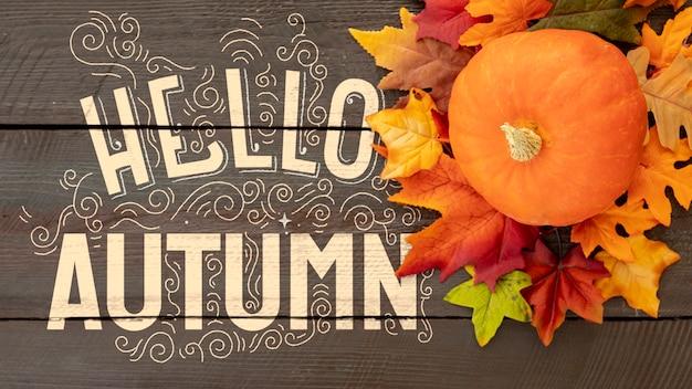 Вид сверху привет осень с тыквой и листьями