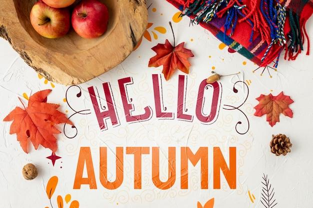こんにちは、乾燥した葉とリンゴの秋のコンセプト