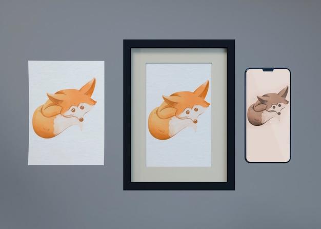 Макет и лист с рисунком лисы
