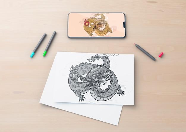 Лист и мобильный с рисунком змей
