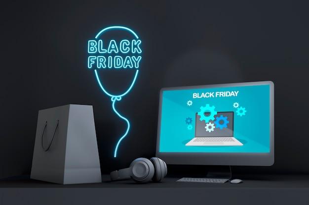 Черная пятница макет компьютера с синими неоновыми огнями