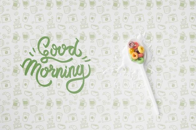 穀物とスプーンの横におはようメッセージ