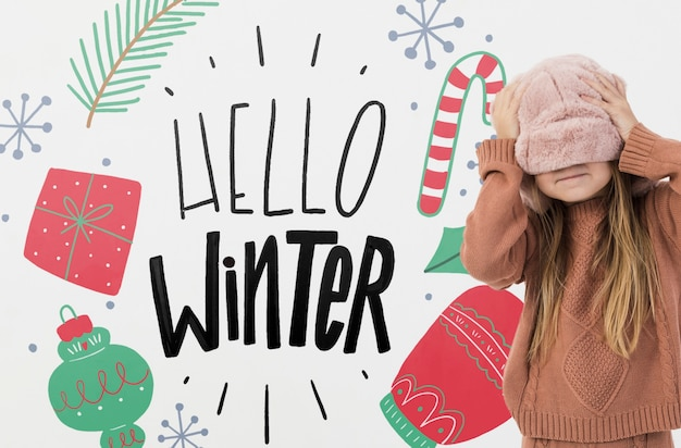 冬の背景を持つかわいい女の子