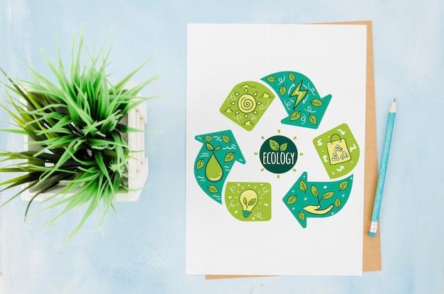 Плоский макет бумажных канцелярских принадлежностей с растением
