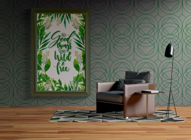 肘掛け椅子の隣の壁に掛かっているフレームモックアップ