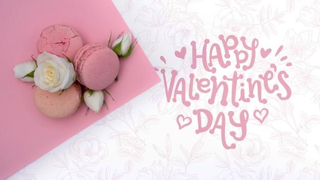 花の背景に幸せなバレンタインデーモックアップ