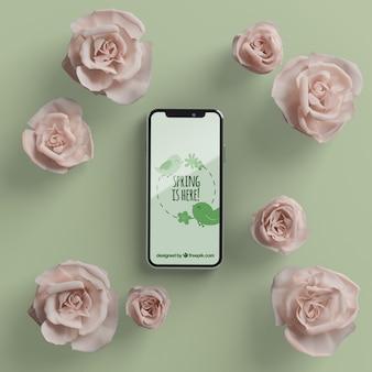モバイルモックアップと花のフレーム