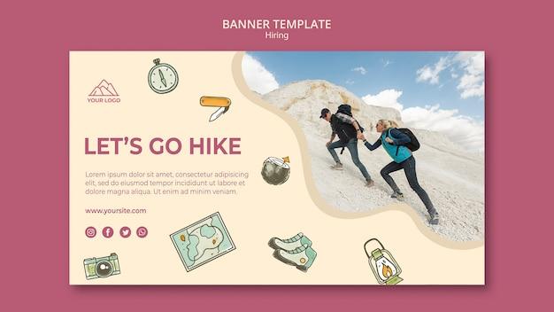 山のバナーテンプレートでハイキングの人々