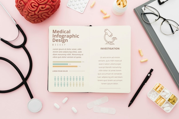 Вид сверху медицинский стол с розовым фоном