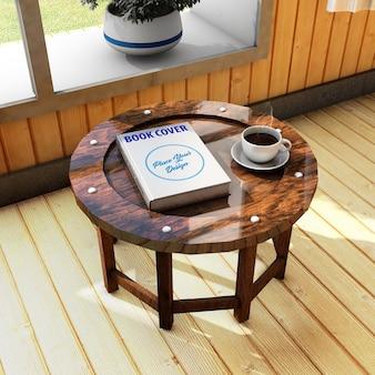 コーヒーテーブルのブックカバーモックアップ
