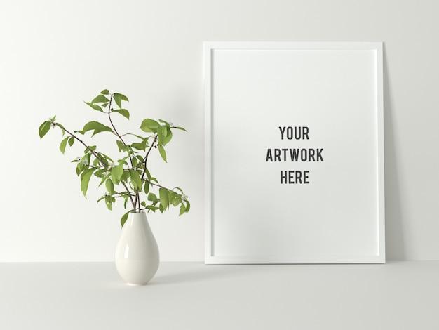 植物と白い最小限のポスターフレームモックアップ