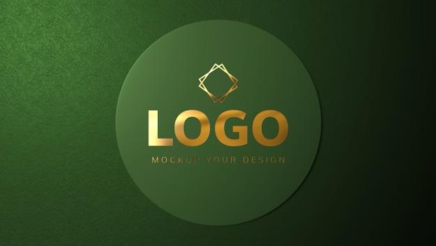 緑の円のデザインにゴールドのロゴのモックアップ