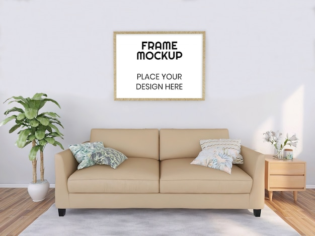 植物とクリーム色のソファと空白のフォトフレームモックアップ