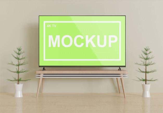 テーブルの正面ビュー画面表示テレビのモックアップ