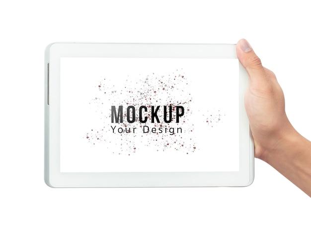 空白の画面のモックアップテンプレートと白いタブレットコンピューターを持っている男性の手