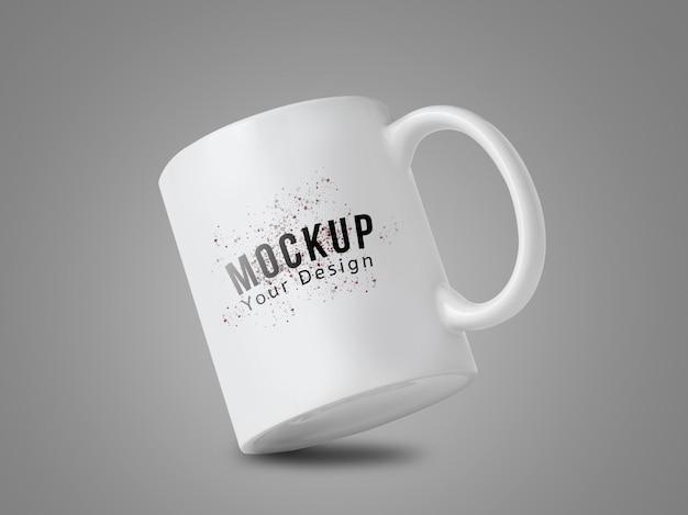 灰色の背景にあなたのデザインの白いマグカップモックアップ