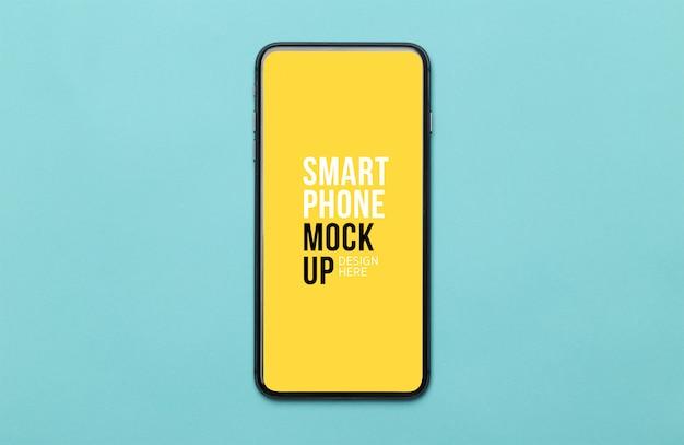 画面のモックアップ付きの黒いスマートフォン