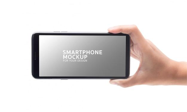 あなたのデザインの黒いスマートフォンモックアップを持つ女性の手。