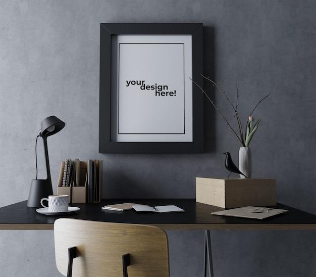 現実的なシングルポスターフレームモックアップデザインテンプレートモダンな黒のワークスペースでコンクリートの壁に肖像画をぶら下げ