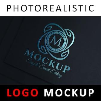 Макет логотипа - синяя фольга с тиснением логотипа на черной карте