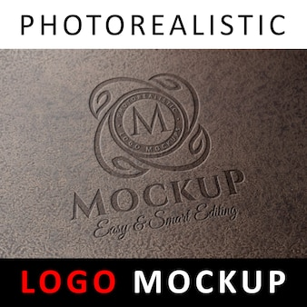 ロゴモックアップ - 粒状の石の表面にデボスロゴ